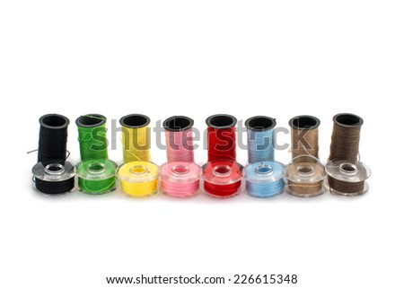 colored threads for embroidery on a white background - stock photo