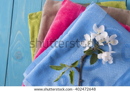 colored towels and flowers - stock photo