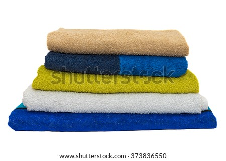 colored towels stacked isolated on white background - stock photo