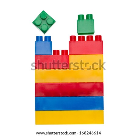 Colored toy bricks isolated on white