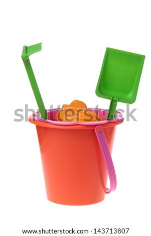 Colored toys bucket, rake, shovel, sieve to play in the sand of the sea