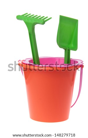 Colored toys bucket, rake, shovel, sieve to play in the sand of the sea - stock photo