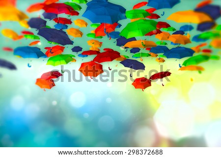 Colored umbrellas in the sky on bokeh background - stock photo