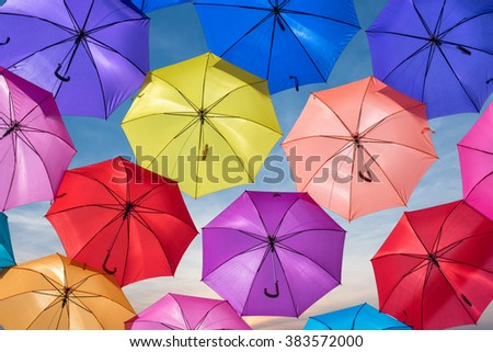 colored umbrellas with sky sunset background - stock photo