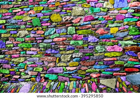 Colored Wall built of stones - stock photo