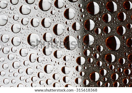 Colored Water Drops on a smooth glass surface - stock photo