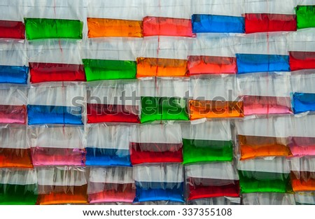 Colored water in plastic bags for a background.  - stock photo