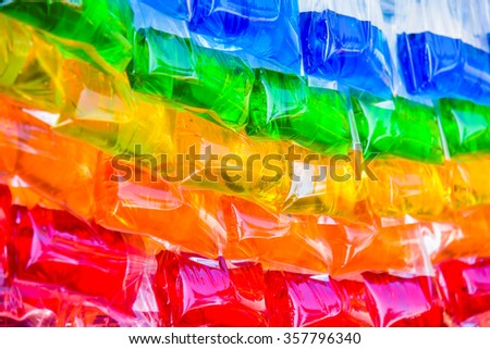 Colored water in plastic bags for a background.