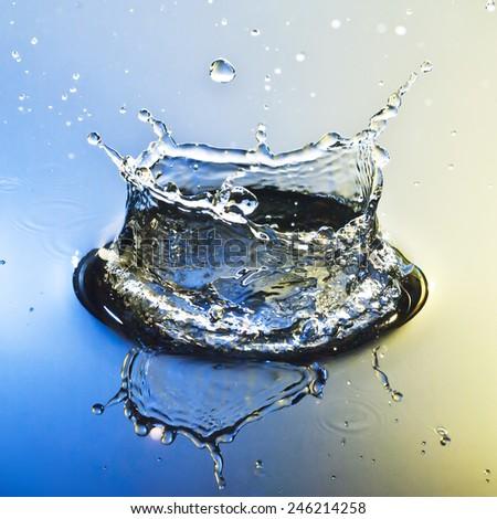 colored Water splash - stock photo