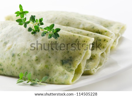 colored with spinach pancake with vegetables - stock photo