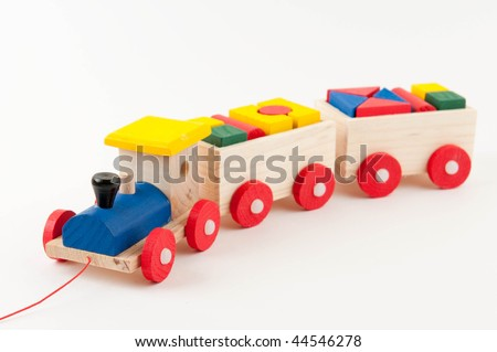 colored wooden toy train on white background