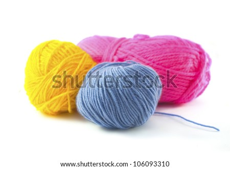 colored wool clews stack