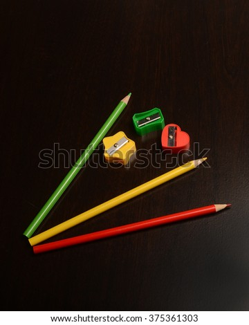 Colored writing implement/Pencils and Sharpeners/Drawing tools on a dark surface