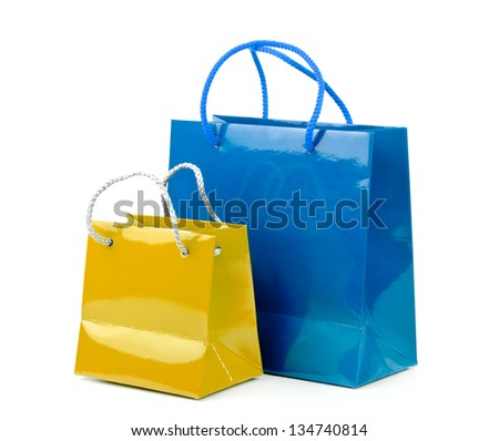 Coloreds shopping bags on a white background. - stock photo