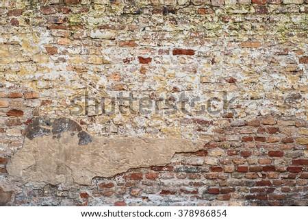 colorful abandoned grunge cracked brick stucco wall background - stock photo