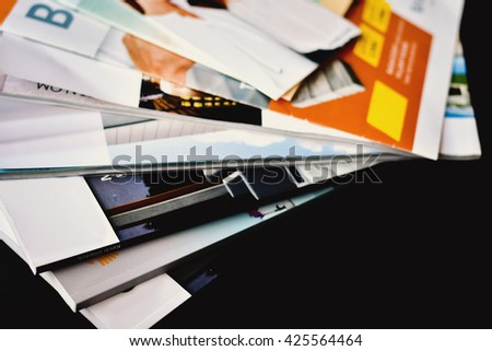 Colorful abstract background image of stacked magazines. - stock photo