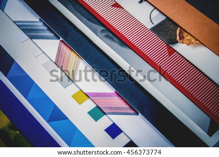 Colorful abstract background image of stacked magazines.