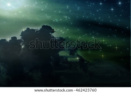 Colorful abstract background of space with nebulae and stars in blue, green and dark colors