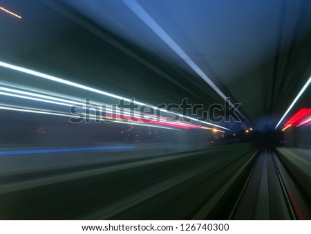 Colorful abstract blurred speed motion view in tunnel - stock photo