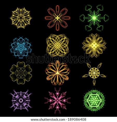 Colorful abstract glowing special light effect Mandala on black background - stock photo