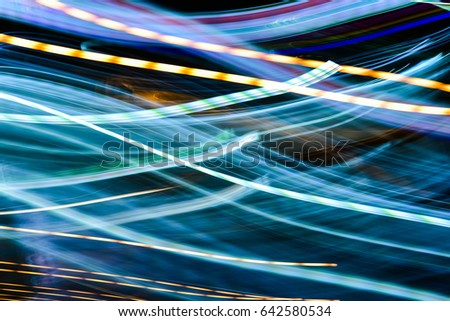Colorful abstract glowing twirl lines at night.