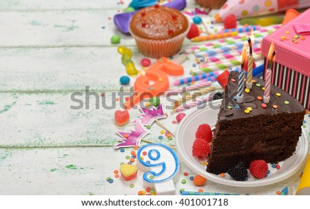 Colorful accessories for children's parties on a white background - stock photo
