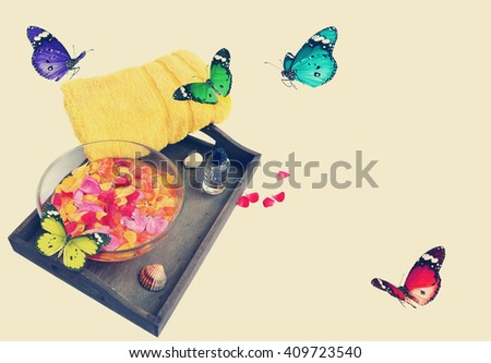 Colorful accessories for SPA and butterflies. Vacation theme. Toned vintage colors - stock photo