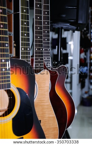 Colorful acoustic guitars  in the store background - stock photo