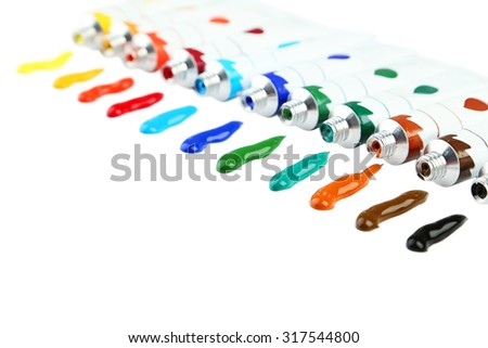 Colorful acrylic paints in tubes on white background - stock photo