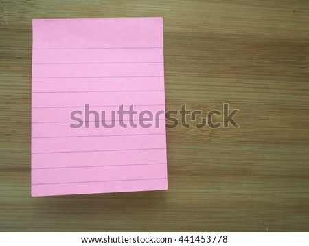 Colorful adhesive papers on wooden board  - stock photo