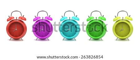 Colorful alarm clocks isolated on white background - stock photo