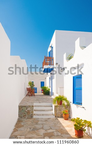 Colorful alleyway from a town on the island of Sifnos, Greece - stock photo