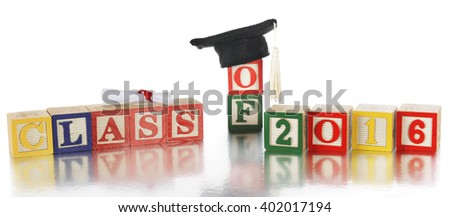 "Colorful alphabet blocks arranged to spell ""Class of 2016.""  A rolled diploma and mortarboard with tassel rest on top.  On a white background. - stock photo"