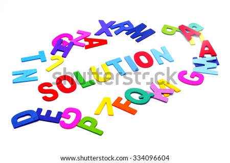 Colorful alphabet blocks of SOLUTION word over white background