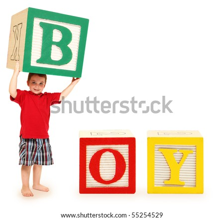 Colorful alphabet blocks spelling the word boy with letter b held by adorable three year old boy. - stock photo