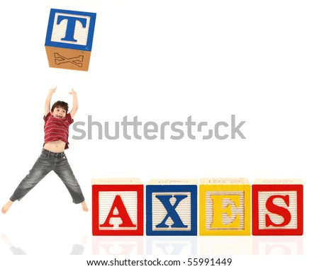 Colorful alphabet blocks spelling the word TAXES.  Adorable seven year old boy jumping and throwing block in air.