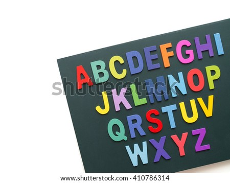 Colorful alphabet collection set on blackboard - isolated capital letters on white background