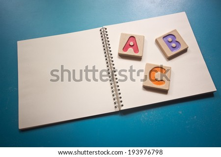 "Colorful alphabet letters ,""abc"" on the book - stock photo"