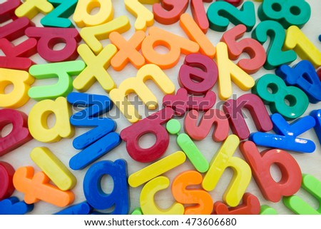 Colorful Alphabet magnetic letters on wooden background