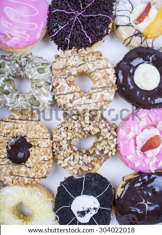 Colorful and assorted donuts - stock photo
