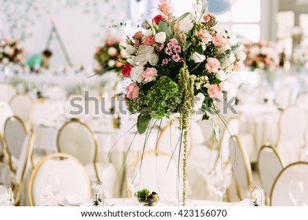 Colorful and beautiful flower bouquets on the table - stock photo