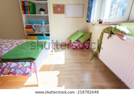 Colorful and bright kids bedroom from the inside - stock photo