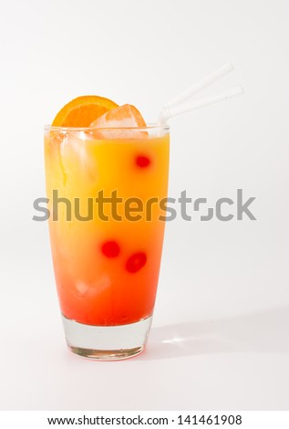 Colorful and cold punch cocktail in a long glass - stock photo