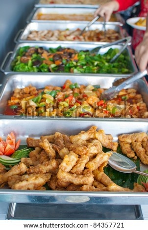 Colorful and delicious looking buffet style delicacies served in trays. - stock photo