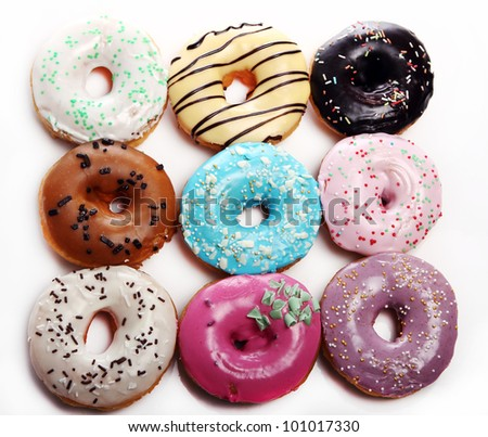 Colorful and tasty donutsover white background - stock photo