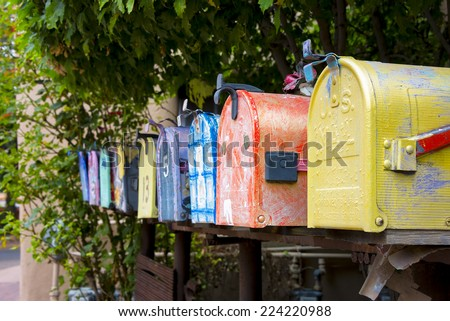 Colorful antique mailboxes on Canyon Road in Santa Fe, NM - stock photo