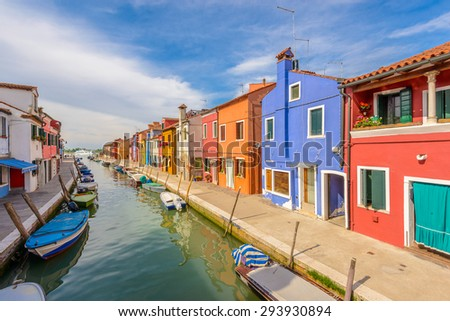 Colorful apartment building with nice waterfront view in Burano, Venice, Italy. - stock photo