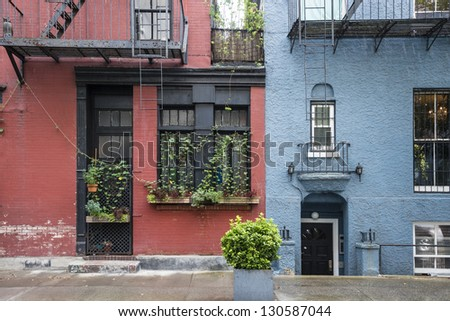 Colorful apartment buildings in Greenwhich Village, New York City - stock photo