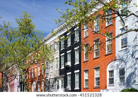 Colorful apartment buildings on Macdougal Street in the Greenwich Village neighborhood of Manhattan in New York City - stock photo