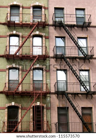 Colorful apartments and fire escapes in New York. - stock photo